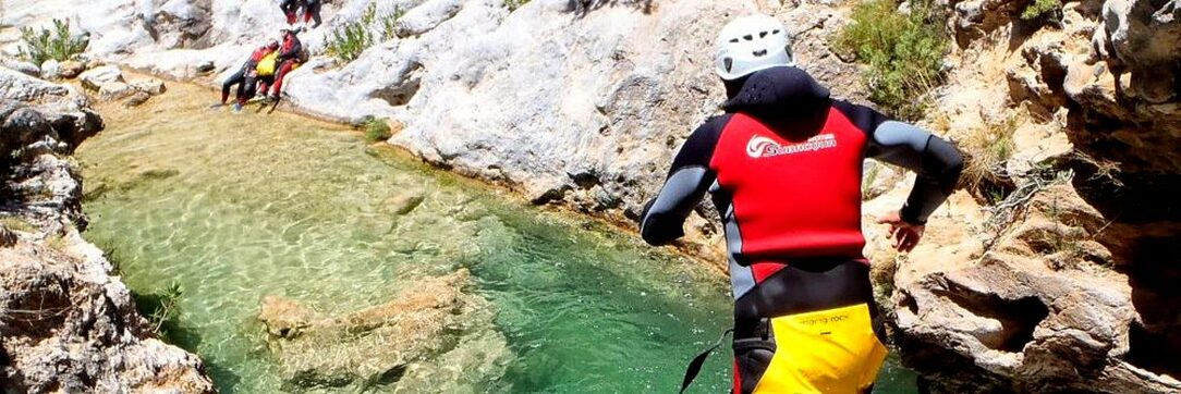 Marbella canyoning jumping into a rock pool